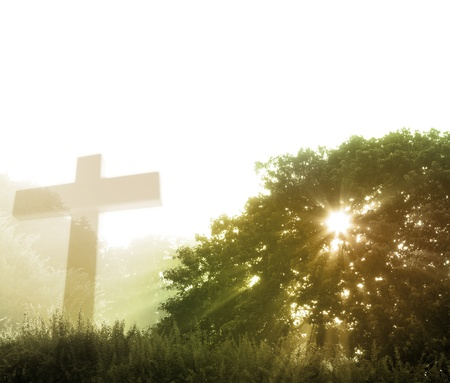 christian faith: Early morning scene of rays of sunlight and cross. Copy space                        Stock Photo