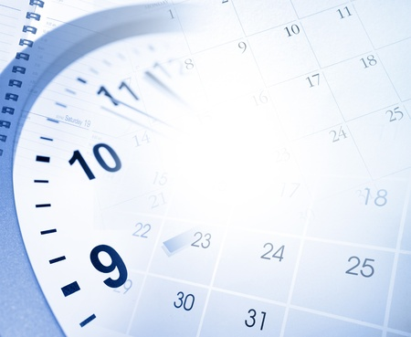 Clock face and calendar pages photo