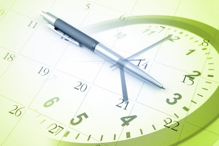 Pen, clock and calendar photo