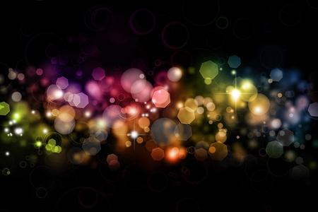 боке: Аннотация размывает цвета на темном фоне Фото со стока