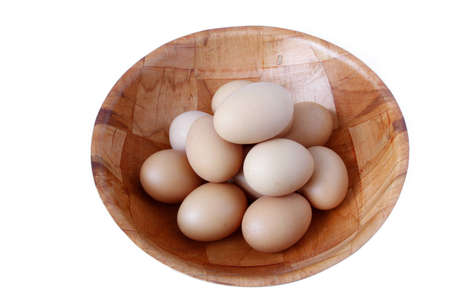Closeup of eggs in bowl on plain background Stock Photo - 12876445