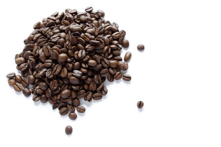 caffiene: Closeup of coffee beans on plain background