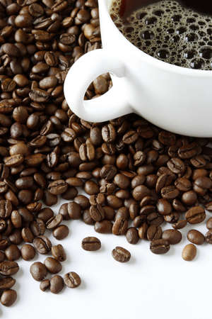 Cup of black coffee on beans Stock Photo - 12876279
