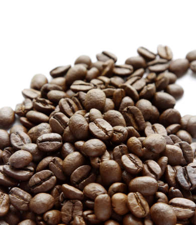Closeup of coffee beans on plain background Stock Photo - 12876275