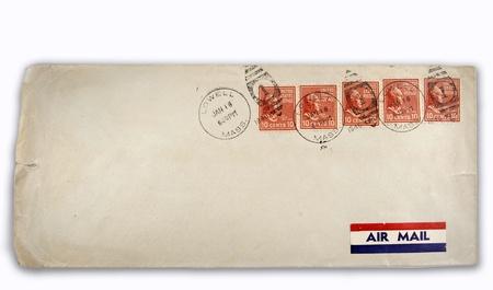 Five postage stamps on old envelope photo