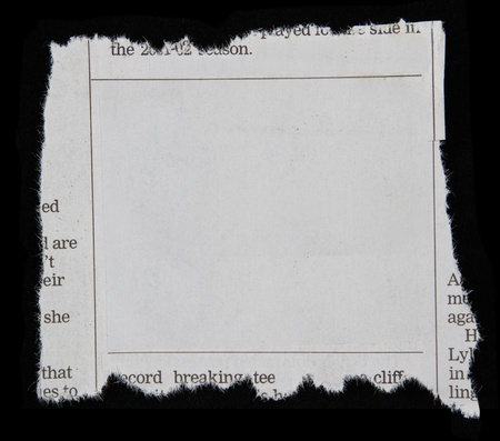 torn paper edge: Newspaper clipping on black background