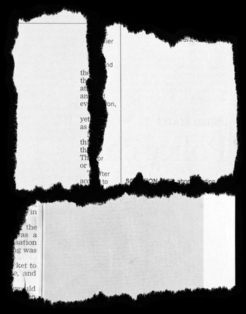 Newspaper clippings on black background