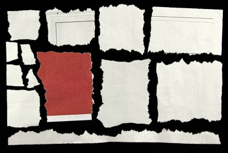 Pieces of torn paper on black Stock Photo - 12931135