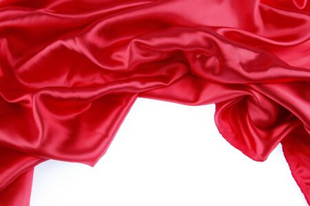 Red silk fabric on plain background photo