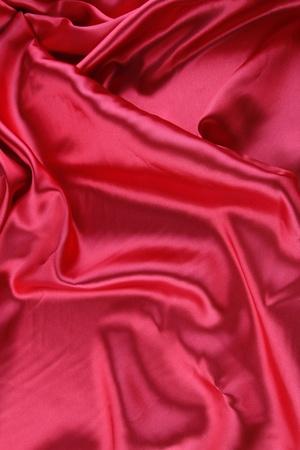 Closeup of red silk fabric photo