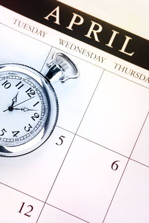 annual events: Pocket watch on calendar page