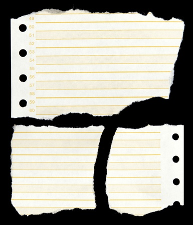 lined: Ripped lined paper on black background