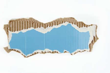 cardboard cutout: Piece of cardboard on plain background