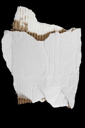 cardboard cutout: Torn cardboard on black background Stock Photo