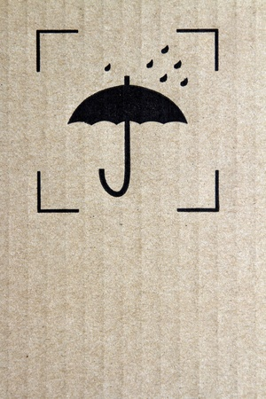 Umbrella and rain symbol on cardboard photo