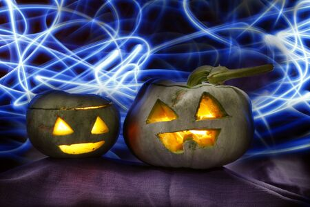 Halloween pumpkin lanterns and blue lights photo