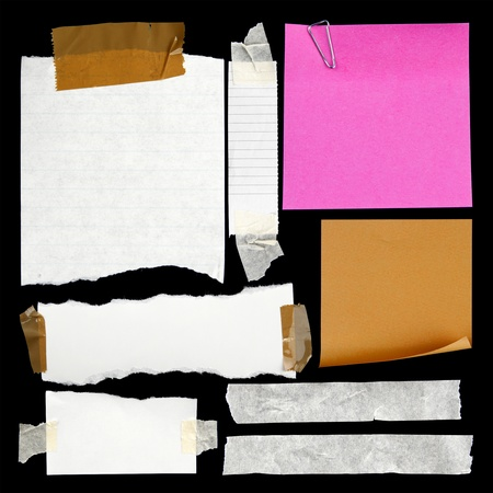 scrap paper: Pieces of torn paper and adhesive tape on black