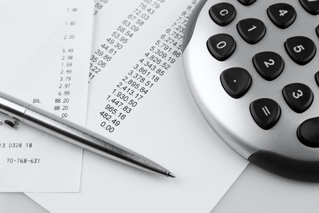 Closeup of financial figures, pen and calculator photo