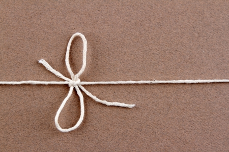 pack string: Tied knot on brown parcel Stock Photo