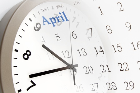 Clock face and calendar page photo