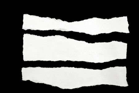 Torn pieces of paper on black background Stock Photo - 13330382
