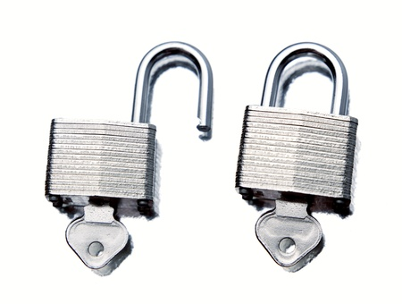 Padlocks on plain background photo