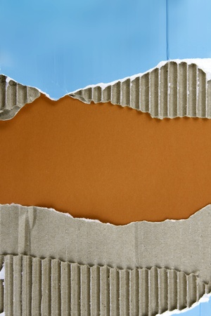 Hole ripped in corrugated cardboard photo
