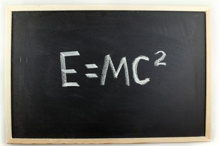 E=mc2 written in chalk on blackboard photo