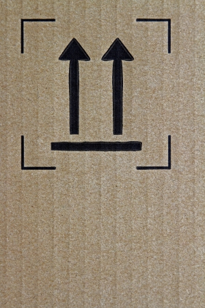 Arrows printed on cardboard box photo