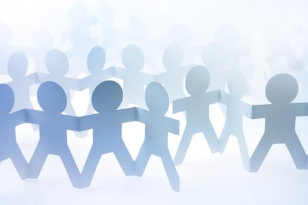 población: La gente de papel mu�eca de la mano