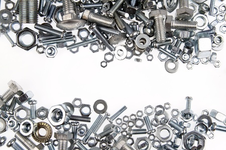 Chrome nuts and bolts closeup on plain background Stock Photo - 13750066