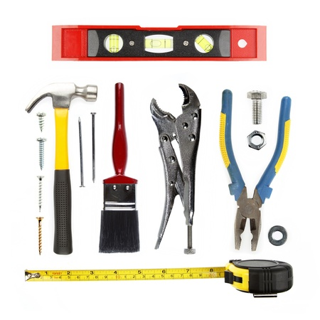Varied tools on plain background photo