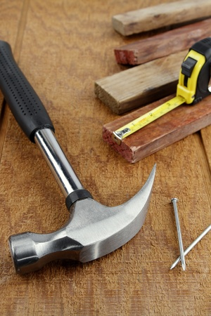 Assorted work tools on wooden surface photo