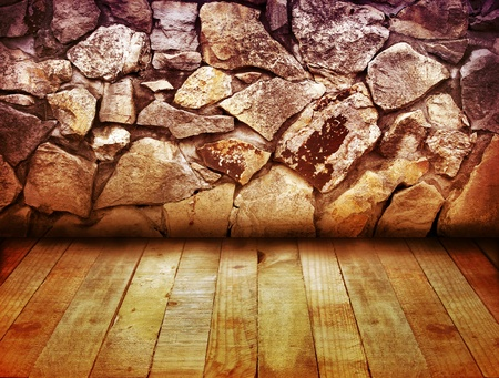 floorboards: Wooden floorboards and stone wall