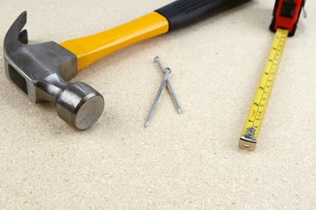 Hammer, nails and tape measure photo