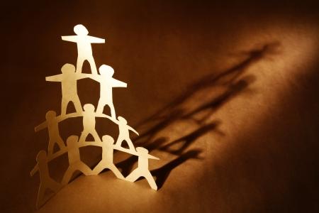 Human team pyramid on brown background Stock Photo - 13950403