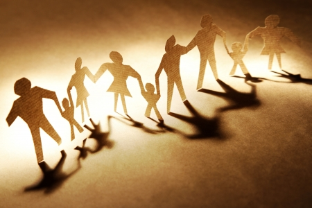 Families holding hands on brown background photo