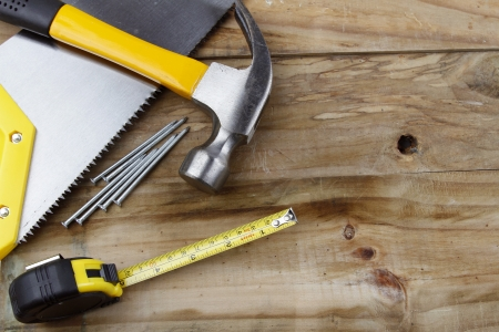 Assorted work tools on wood Stock Photo - 13950410