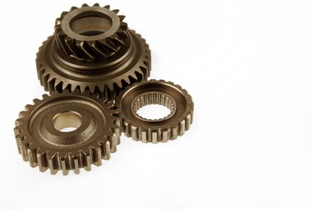 Three metal cogs on plain background photo