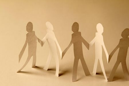 Paper doll cutouts holding hands photo
