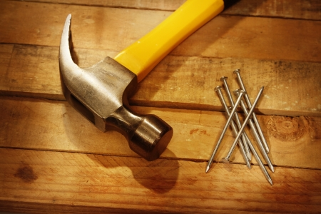 Hammer, nails and pieces of wood Stock Photo - 14029650