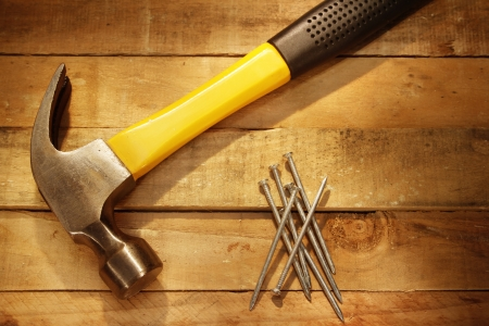 Hammer, nails and pieces of wood Stock Photo - 14029689