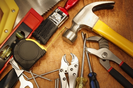 Assorted work tools on wood Stock Photo - 14029691