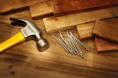 Hammer, nails and pieces of wood Stock Photo - 14029686