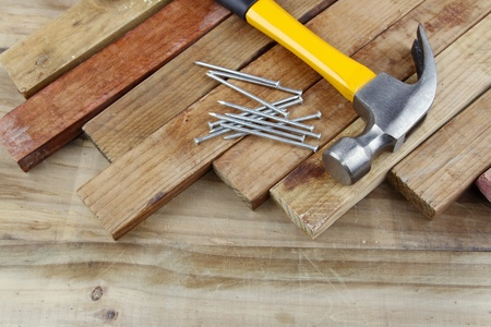 Hammer, nails and pieces of wood Stock Photo - 14029687
