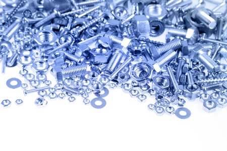screw: Nuts and bolts on plain background