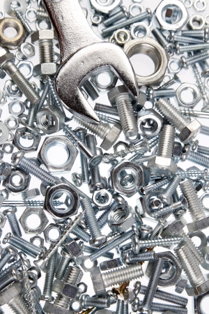 Wrench on nuts and bolts photo
