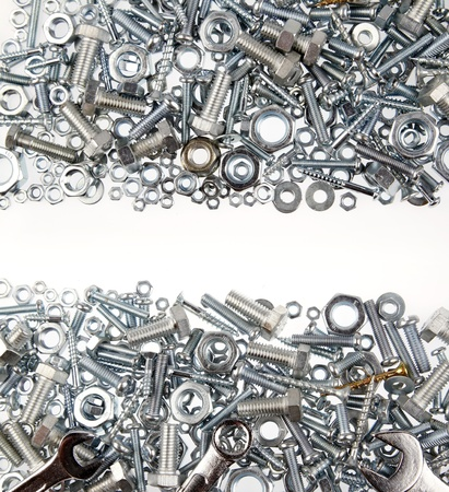 Nuts and bolts on plain background photo