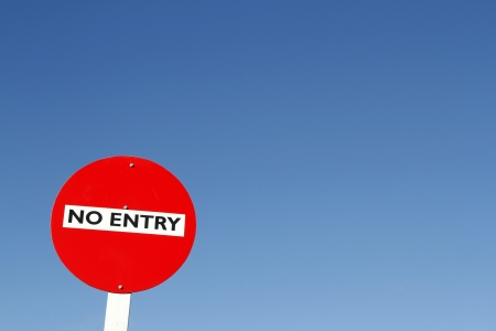 restricted: No entry sign against blue sky Stock Photo