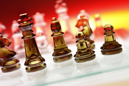 symbolics: Game of glass chess pieces Stock Photo